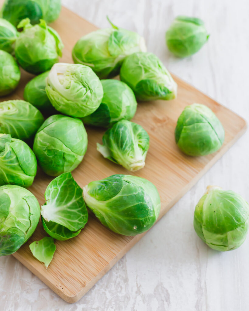 Brussels sprouts on a cutting board.