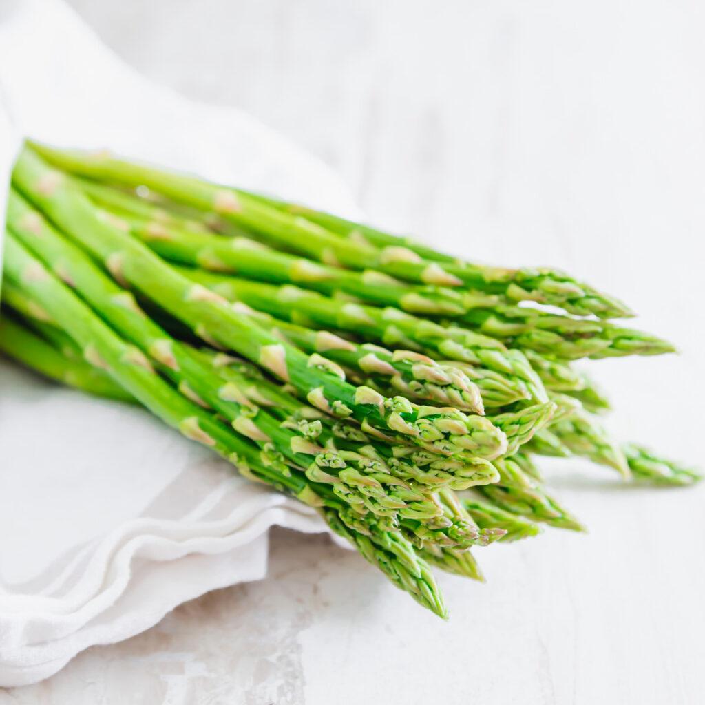 asparagus bunch, raw on a table with a cloth