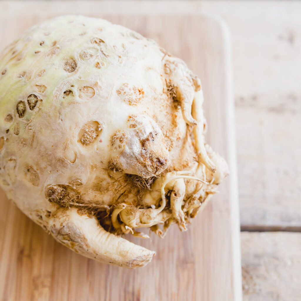 Celery root on a cutting board.