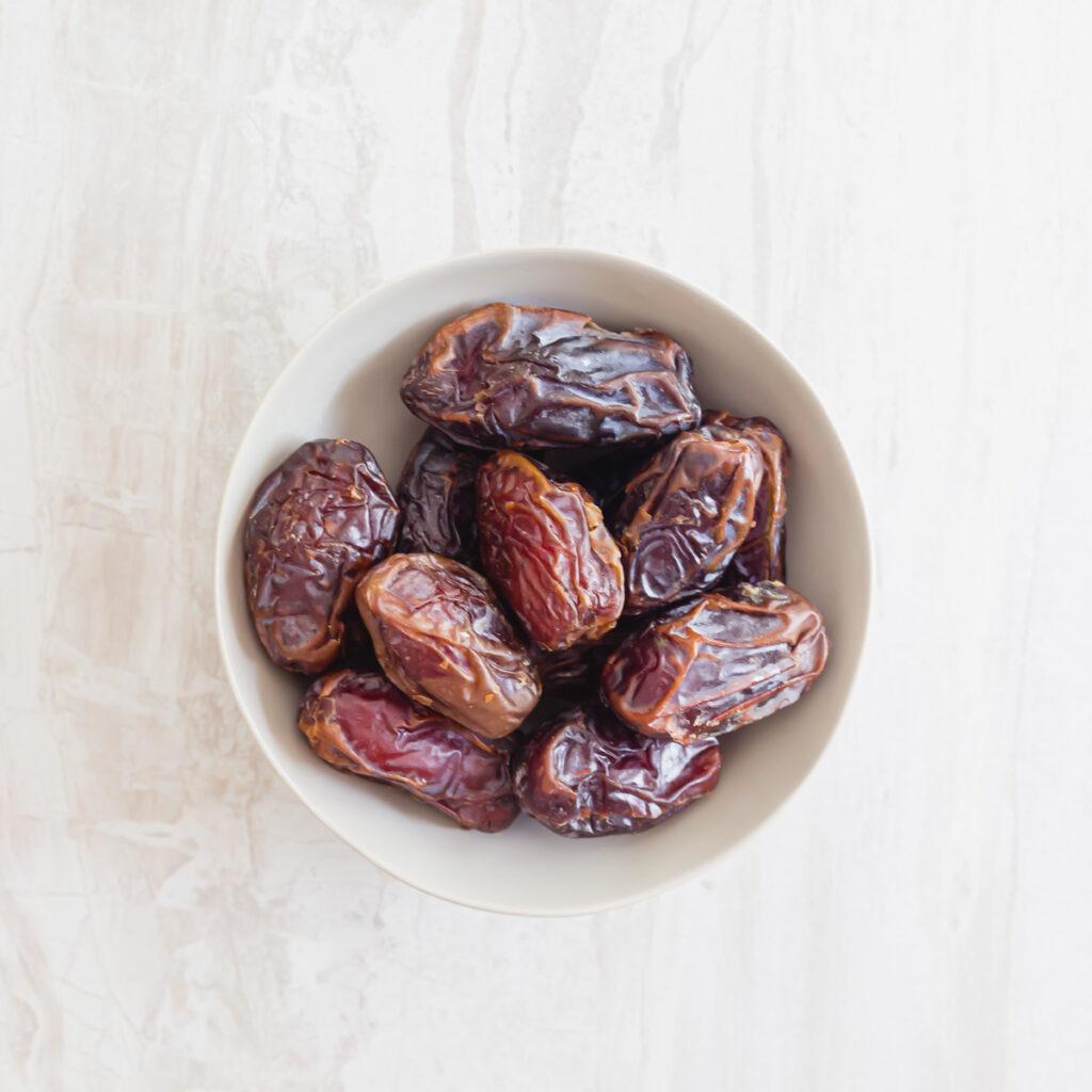 Dried medjool dates in a bowl.