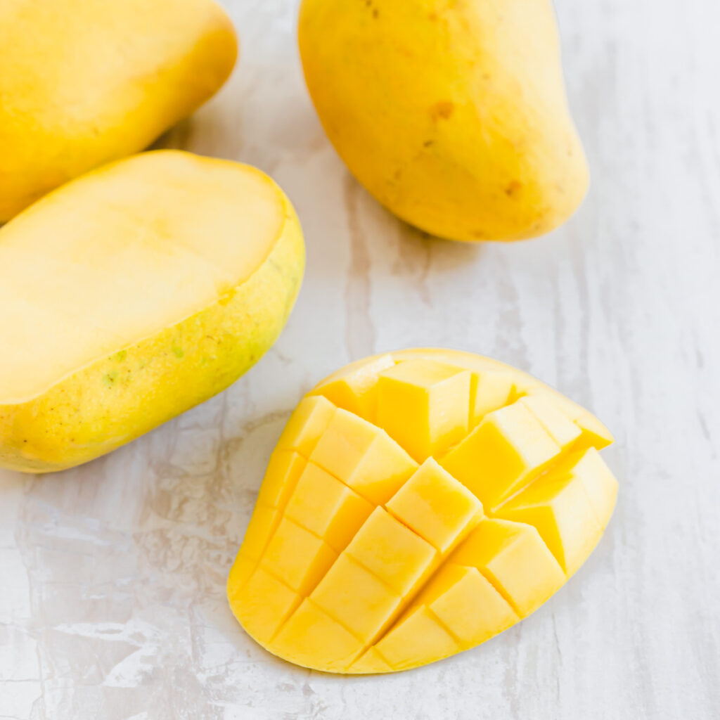 Half a mango sliced into cubes in the peel.
